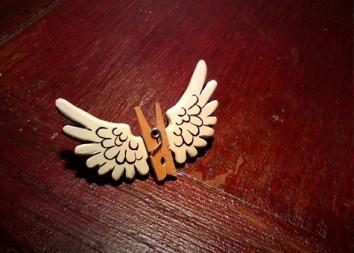 Pegasus broach in resin and wood.
